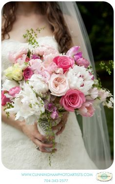 Clutch of festiva maxima peonies, pink tulips, sweet pea, ranunculus, roses, spray roses and garden roses, with touched of yellow and wispy accents of maidenhair fern - Photographed by Cunningham Photo Artists.
