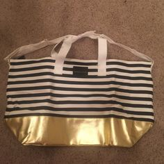Brand new, Victoria's Secret overnight bag NWT striped black, white and gold trimming Carry on , over night bag! Victoria's Secret Bags Totes
