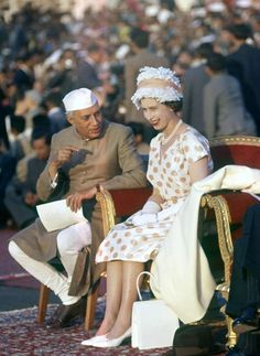 Wearing a feathered hat that would rival countless Easter bonnets, the Queen stood out in pristine white and peach polka dots against a sea of suits in Delhi, 1961.