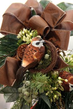 Christmas Tree Topper with bird in brown ribbon trimmed nest. Very natural but elegant look!