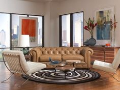 The Chester Sofa is reminiscent of Old English libraries with it's tufted back, caramel leather, and high rolled arms. A great piece for featuring both modern design and traditional touches. | Chester Sofa cort.com