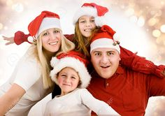 Young Family With Gifts At Christmas Stock Photo, Picture And ...