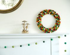 What better way to offer a warm welcome than with a hand-felted wool wreath in autumnal colors? #etsyfinds