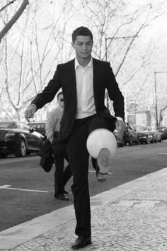 Cristiano Ronaldo!! Playing even in his suit, & sexier than ever <3