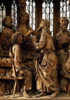 """Tilman Riemenschneider.""""Heiligblut-Altar"""", altar of the Holy Blood, detail: Jesus holds out the bread to Judas, who clutches the money-bag in his left hand. 1500-1504 Lime-wood   St.Jacob's church,Rotemberg  Germany"""