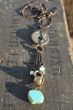 """This necklace has Ancient all over it! We found this ancient coin & bell at a show & fell in love! Using crystal, gemstone and natural brass componets to finish it off. This necklace measures 22"""" in length"""