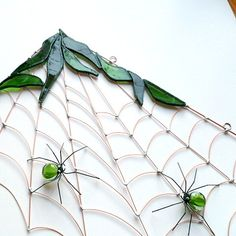 Medium Handmade Copper Wire Corner Spider Web in Greens. $65.00, via Etsy.