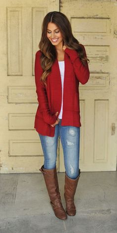 Go for a red shawl cardigan and blue ripped skinny jeans to create a chic, glamorous look. Complement this polished look with dark brown leather knee high boots.  Shop this look for $104:  http://lookastic.com/women/looks/dark-brown-knee-high-boots-and-blue-skinny-jeans-and-white-crew-neck-t-shirt-and-red-shawl-cardigan/4091  — Dark Brown Leather Knee High Boots  — Blue Ripped Skinny Jeans  — White Crew-neck T-shirt  — Red Shawl Cardigan