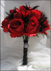 red rose and black feather bouquet with some bling