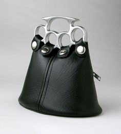 though the purse isn't my exact style, is is pretty legit! brass knuckles? you are now safe from getting mugged... genius!!