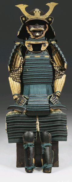 Takenaka Clan - blue laced Gusoku. Edo period (18th century)  Gusoku lacquered black and laced in blue with the lowest lame of each component lacquered gold with an ishime finish and decorated with gamboling Chinese lions or scrolling vines in black lacquer. The armor comprising of a fifty-six plate russet-iron hoshi-bachi; the mabi-sashi finished with gilt-copper fukurin carved with scrolling vines, the four-lame neck guard ending in black-lacquer fuki-gaeshi applied with gilt-copper…