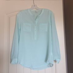 Pale Blue silky blouse NWT. Button placket pale blue semi-sheer blouse - almost identical to the portofino top. Perfect condition. Old Navy Tops