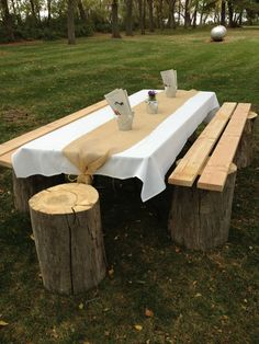 Easy kids table at an outdoor wedding - stumps with boards screwed in - take off boards when done, instant outdoor end tables for the fire pit.