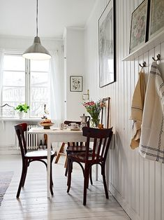 This reminds me of a simple Scandinavian home with lots of wood everywhere. I prefer more natural wood color, but this picture captured the simple style that I like in Scandinavian homes