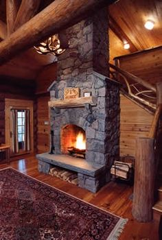 1000 images about for my someday log cabin on pinterest for Cabin fireplace pictures