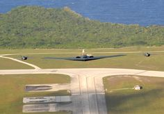 Two F-22A Raptor Stealth Fighter Jets and One B-2 Spirit Stealth Bomber Fly In Formation Over Andersen Air Force Base, April 7, 2009