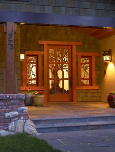 Craftsman Style traditional entry- Amazing tree stained glass door and windows.