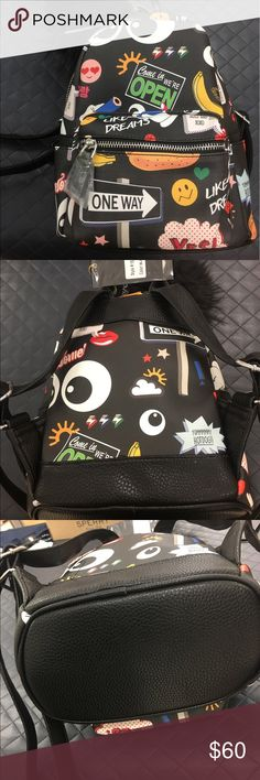 LeSportsac Black Eyes 👀 Backpack If your looking for something different. This mini backpack should be in your closet. Approximately 8.25x10.25x4.50. And is stylish and ready to go.  Made of Vegan Leather. Zipper closings.  Detachable compound. Outside super pocket. To slip side pockets. When slip pocket and one simple wall pocket inside. Like Dreams Bags Backpacks