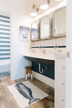 Shared kids' cottage bathroom features three Restoration Hardware Submarine…