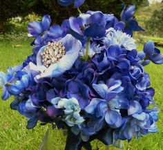 brides2bouquets  -  blue hydrangea, japanese anemone, cornflower with brooch detail.
