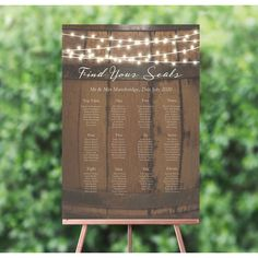 Unique, rustic and effortlessly fitting into your wedding day, this seating plan is an essential so guests can find their seat at your wedding. Wedding Table Assignments, Wedding Table Seating, Wedding Day Groom Gift, White Table Settings, Fairy Lights Wedding, Elegant Wedding Favors, Bridal Shower Centerpieces, Sparkle Wedding, Wedding Signage