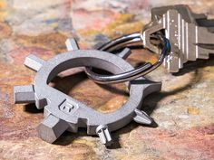 This keyring multitool, discovered by The Grommet, is a lightweight keychain tool set that includes 8 screwdrivers, 2 wrenches, and a bottle opener.