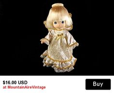 Precious Moments Angel Tree Topper   This is an adorable Precious Moments angel tree topper doll. This is a wonderful and whimsical delight for your Christmas tree. She was designed by the artist Sam Butcher.  #preciousmoments #christmas #angel #treetop #vintage #mountainairevintage