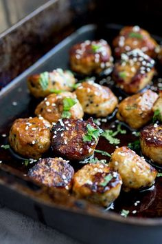 Sweet, sticky and delicious. These tray baked sticky sesame chicken meatballs are packed with flavour and bake easily in the oven for a perfect week night meal.  #cooking #recipe #recipeoftheday #chicken #meatballs