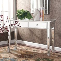 @Overstock - Perfect for any room, this glamorous mirrored entrance accent table will perfectly complement your home. With its mirrored finish, it adapts to any surroundings without being overpowering.http://www.overstock.com/Home-Garden/Dalton-Mirrored-Accent-Table/5400861/product.html?CID=214117 $222.99