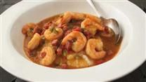 Tender cheesy grits are served with cooked shrimp and bacon in a Carolina brunch classic.