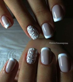 nail design with beige polish with a rounded white tip and accent nail with delicate white swirls