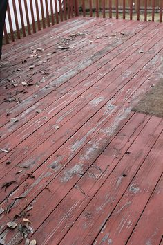 stain the deck by covering the old existing stain with a solid color stain.