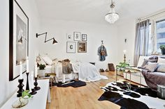 Studio apartment decorate idea. Minimal furniture, light colors and art on the walls. Looking for beautiful, unique and affordable art photo prints to decorate your studio? Visit bx3foto.etsy.com