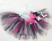 Pirate Tutu: butterfly, feather, floral embellishment with sparkle black mesh fabric, vibrant pink sparkle and white tulle.