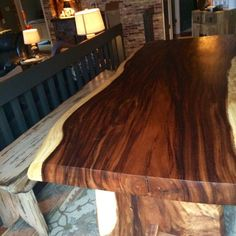 Live edge with a hand crafted custom trestle base
