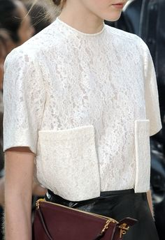 This is a very chic square crop top. The lace plays a subtle but very important role in making it such an interesting shirt. https://bellanblue.com