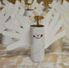 Hand print angel with toilet paper tube