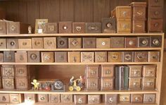 old sewing machine drawers ~ create a wall of them...reminds me of an apothecary table