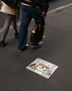 Milan commissions artists (Shepard Fairey, Invader, The London Police, Flying Fortress, Rendo) for manhole covers