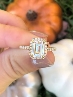 This A.Jaffe emerald cut diamond engagement ring in yellow gold features a halo setting and pave diamonds running halfway down the semi-mount from Diamonds Direct #ajaffe #emerald #emeraldcut #diamond #diamonds #engagementrings #yellowgold #gold #halo #pave #diamondsdirect