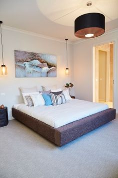 Master bedroom, feature lighting, neutral colour scheme, display home, paul gray builders