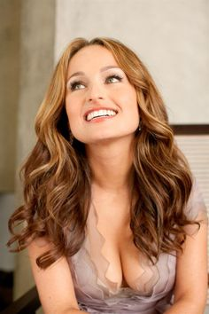 Giada de Laurentiis' hair. More like mine but if I only had the patience and time to curl it!!!  ;(