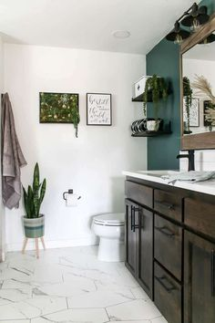 - Making Manzanita - This bathroom has a brand new layout with his and her dual head walk in shower on one side and the toilet and dual sink vanity on the other. I love the dark green accent wall and succulent wall decor in frame. Bathroom Accent Wall, Bathroom Accents, Boho Bathroom, Modern Bathroom, Shiplap Bathroom, Bathroom Ideas, Bathroom Layout, Bathroom Wall Decor, Bathroom Organization