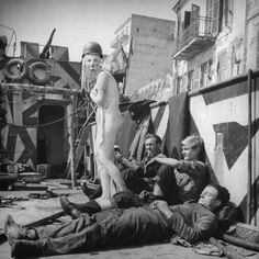 "The Allies at Anzio: Rare Photos From WWII's Italian Campaign | LIFE.com Not published in LIFE. American soldiers relax with their mascot, ""Axis Sally,"" which was ""liberated"" during the battle for control of the Anzio beachhead, 1944. Read more: Anzio: Rare and Classic World War II Photos From Italy 