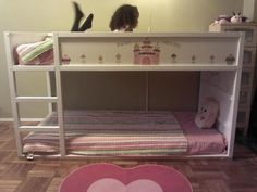 I bought this Ikea Kura bed on Craigslist. I painted the entire bed frame white. Then I ordered cupcake themed wall decals and placed them on the panels.  And just like that- my girls have a cupcake bunk bed that they adore!