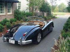 My mother's dream car.                                         Classic....1956 Jaguar XK140 OTS