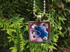 Blue Feather and Pink Sequined Resin Jewelry Pendant - Three Demensional with resin- wearable art by Terripoppinscrafts. $12.00, via Etsy.
