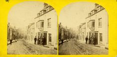 """An old photo of Wendron Street, Helston, Cornwall, showing a family group of """"Granpa, Mother, Grandma, Auntie, Father"""" and their dog outside Dudley's and No 11 which was their family home. Taken about 1890.  From Helston Museum's photographic collection."""