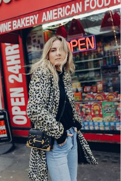 Lucy Williams of Fashion Me Now told us her tips for breaking into the fashion industry and the secret to having a true sense of style. Wearing Mango leopard coat, Prada bag, vintage Levi's and red boots. London street style.