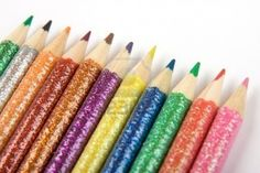 A line of glittery, multi-colored pencil crayons Stock Photo